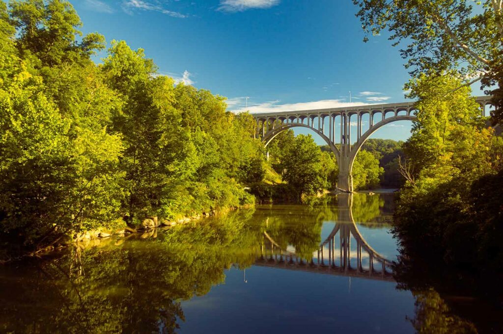 Arch bridge spanning a river in Cuyahoga Valley National Park in Ohio