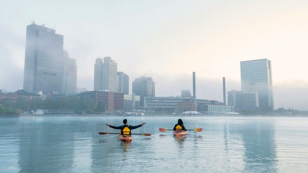 Paddlers-in-Toledo Ohio with city in background
