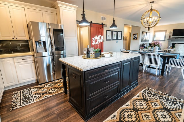 The Kitchen In The Kinston Homestead II At Our Hartland Model Center  Features Shawu0027s Durable Uptown Canton Street Luxury Vinyl Tile Flooring.